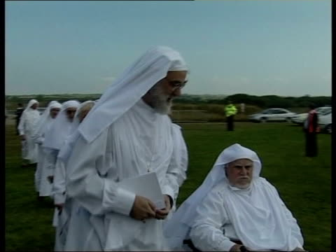 druid ceremony ms williams towards past wearing white robes pan - paganism stock videos and b-roll footage