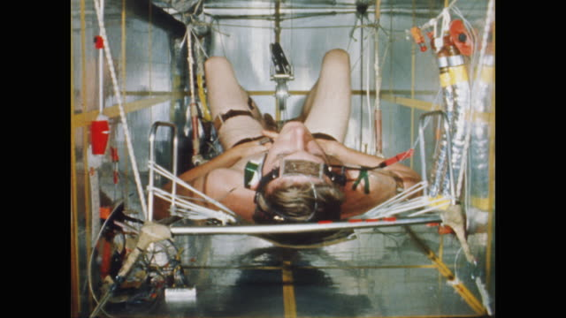 dr theodore benzinger explains how the body reacts to heat as the project mercury astronauts train in a radiant heat calorimeter - 1958 stock videos & royalty-free footage