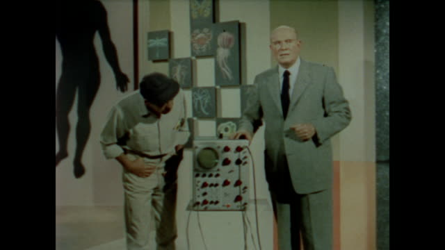 1958 dr. wilder penfield uses dr. max baxter to demonstrate that outside stimulation activates the brain - human brain stock videos and b-roll footage