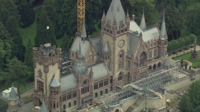 aerial drachenburg castle with scaffolding, north rhine-westphalia, germany - 復元する点の映像素材/bロール