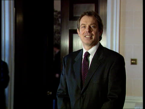draft peace deal; itn n ireland: belfast: hillsborough castle: ext pm tony blair mp greeted on arrival at building int blair posing for photocall pm... - ulster province stock videos & royalty-free footage