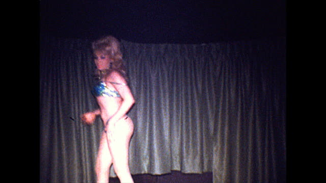 drag performer wearing a blue sequin thong dances with a green scarf on stage - 1960 1969 stock videos & royalty-free footage