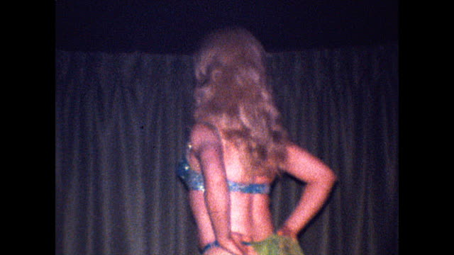 drag performer wearing a blue thong bikini and green scarf dances on stage - 1960 1969 stock videos & royalty-free footage