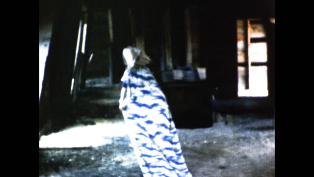 drag queen in long blue dress and golden headdress walking across the field with trees and into the cabin, smiling and posing for the camera by the... - headdress stock videos & royalty-free footage