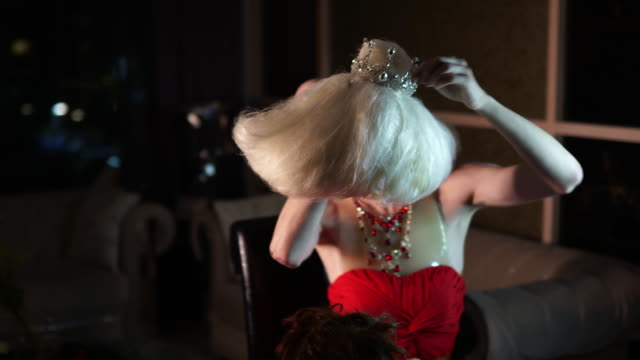 drag queen putting blond wig - drag queen stock videos and b-roll footage