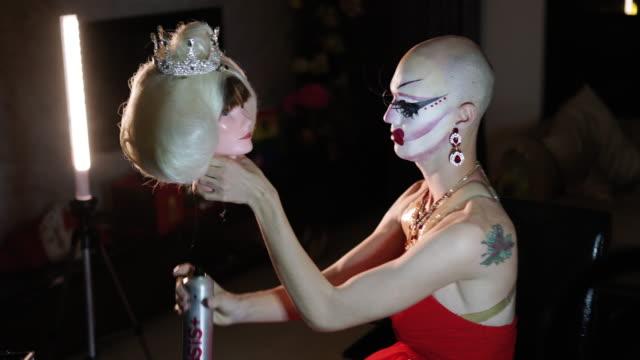Drag queen putting blond wig
