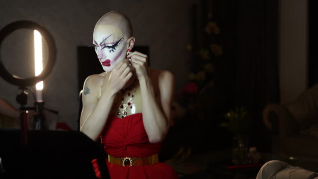 drag queen putting earring - drag queen stock videos and b-roll footage