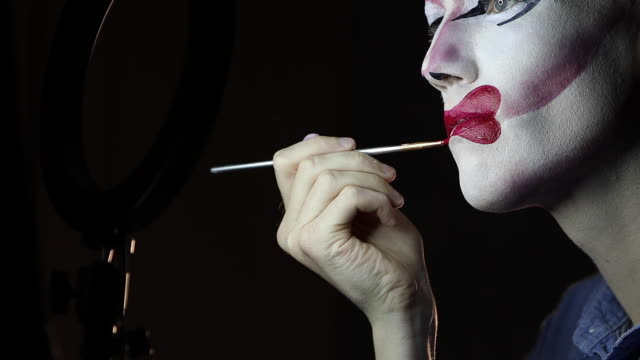 drag queen putting red lipstick in dark room - drag queen stock videos and b-roll footage