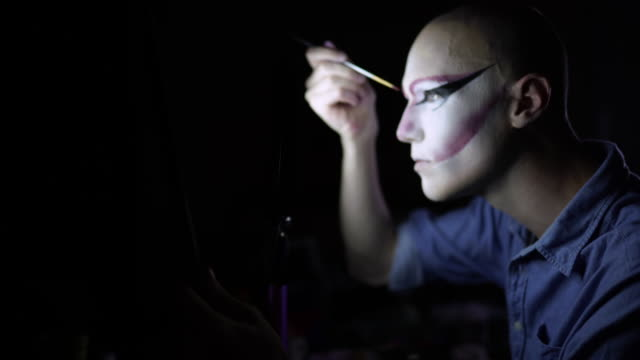 drag queen putting stage make-up for performance - drag queen stock videos and b-roll footage