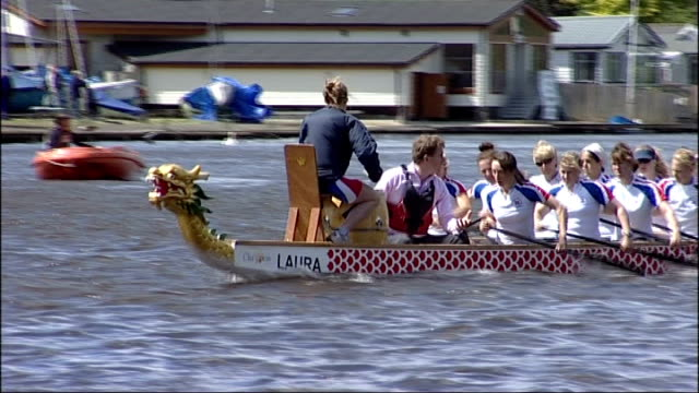 british women's team train for world championships; england: london: kingston: ext view from camera onboard dragon boat of woman paddling hard during... - itv london tonight weekend stock-videos und b-roll-filmmaterial
