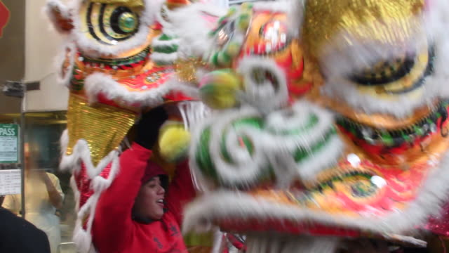 Dragon dance in the street the traditional blessing of local business Toronto Chinatown Chinese New Year Celebration The year of Rooster in one of...