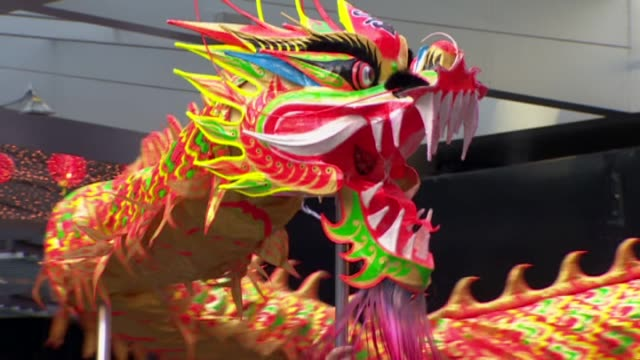dragon dance performance during chinese new year celebrations in auckland - dragon stock videos & royalty-free footage