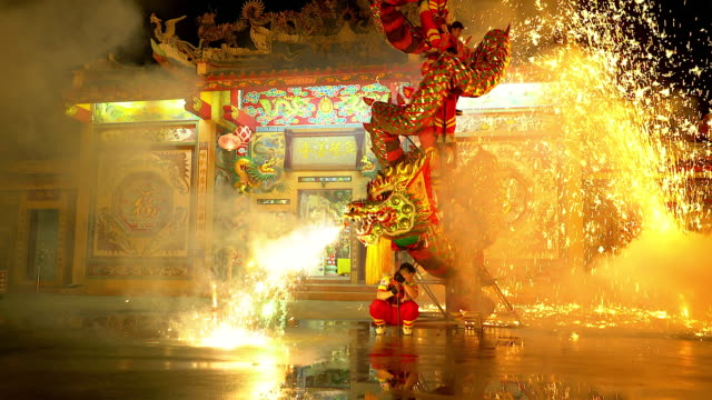 dragon dance show with firework in the festival chinese new year in the night. - dragon stock videos & royalty-free footage