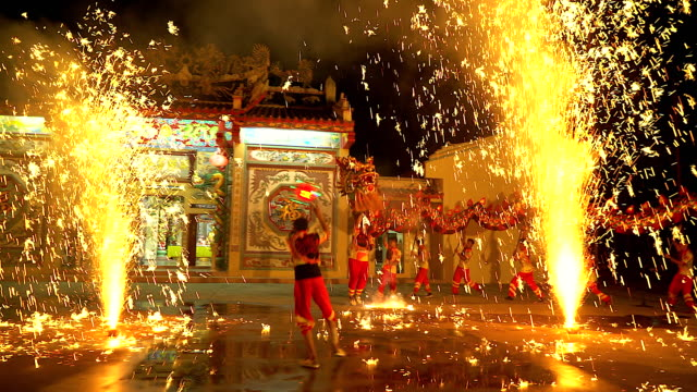 dragon dance show with firework in the festival chinese new year in the night. - cultures stock videos & royalty-free footage