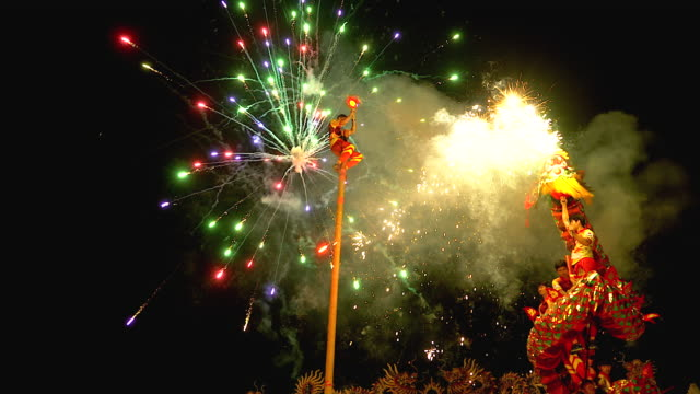 dragon dance show with firework in the festival chinese new year in the night. - chinese culture stock videos & royalty-free footage