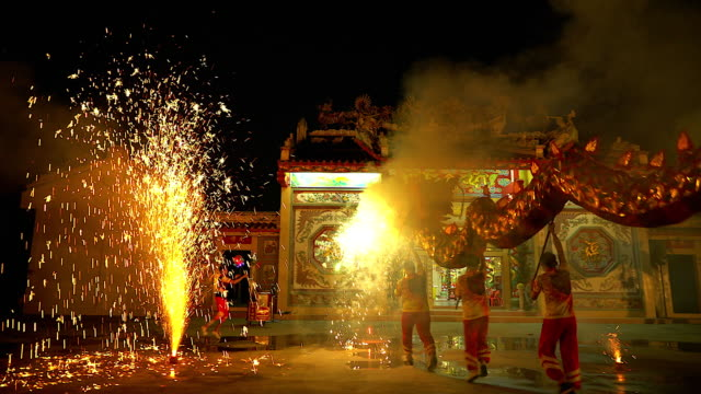 Dragon dance show with firework in the festival Chinese New Year in the night.