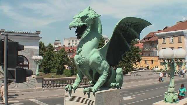 MS Dragon statue on Dragon's Bridge on Ljubljanica River (art nouveau style), Ljubljana, Slovenia