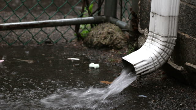drain spout during rain storm - gutter stock videos and b-roll footage
