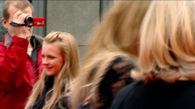 stockvideo's en b-roll-footage met olivier awards england london covent garden ext actress dame helen mirren arriving for the olivier awards actor james mcavoy posing for photograph... - signeren