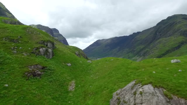 dramatic aerial / drone shot revealing glencoe in the scottish highlands - scottish highlands stock videos and b-roll footage
