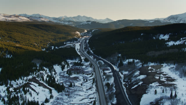 dramatic aerial of landscape in montana with train - glacier national park us stock videos and b-roll footage