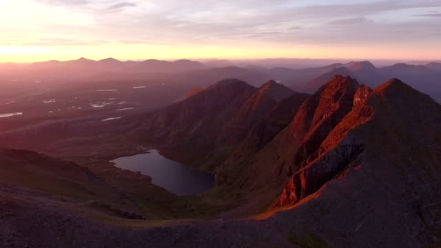 Dramatic aerial shot of An Teallach near Ullapool in the Scottish highlands during sunrise