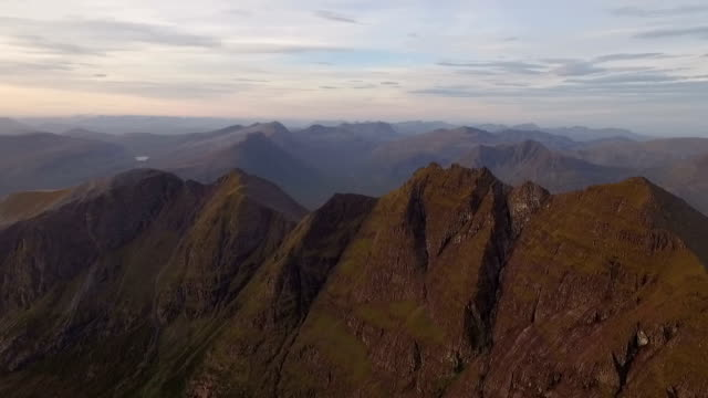 dramatic aerial shot of an teallach near ullapool in the scottish highlands during sunrise - an teallach stock videos & royalty-free footage