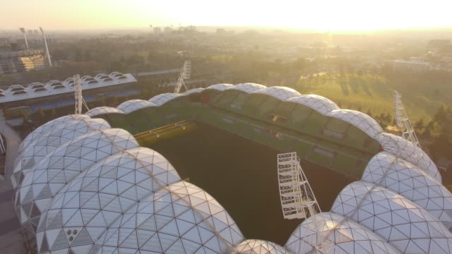 a dramatic aerial view of the aami park at sunrise - david ewing stock-videos und b-roll-filmmaterial