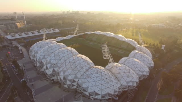 A dramatic aerial view of the AAMI Park at sunrise