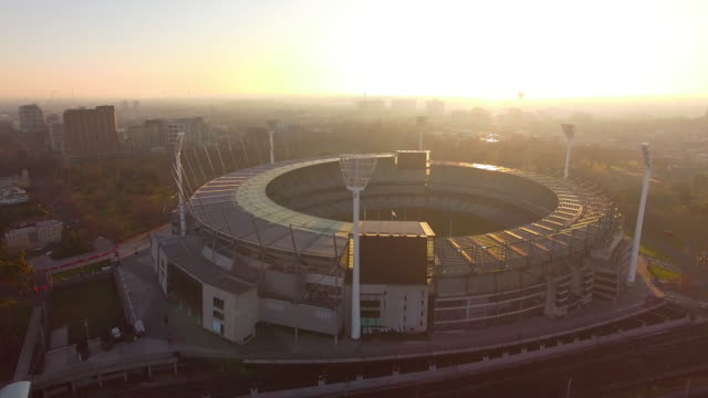 A dramatic aerial view of the MCG Melbourne Cricket Ground at sunrise.
