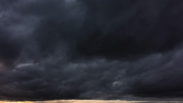 dramatic almost black storm clouds - storm cloud stock-videos und b-roll-filmmaterial