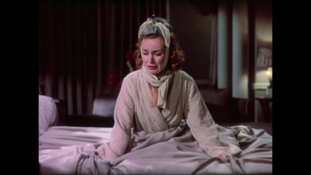 1937 dramatic and emotional woman (carole lombard) acts suicidal while laying in bed - forgiveness stock videos & royalty-free footage