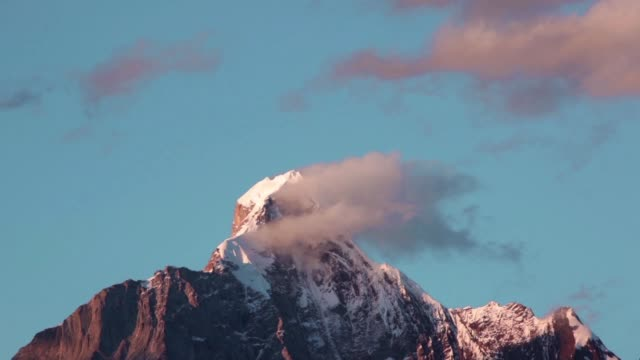 dramatic clouds against mountains - mountain peak stock videos and b-roll footage