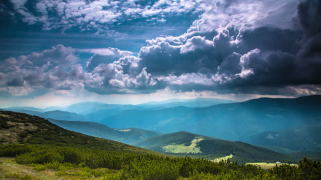 time lapse: dramatic clouds in the mountains - romania stock videos & royalty-free footage