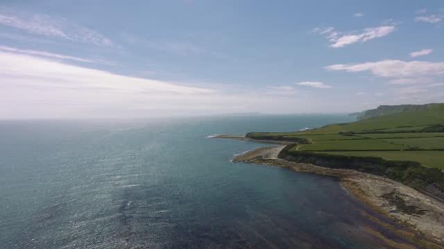 dramatic coastline against blue skies - rock face stock videos & royalty-free footage