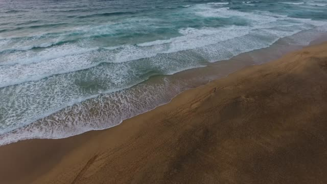 dramatic desert beach in fuerteventura - moving up stock videos & royalty-free footage