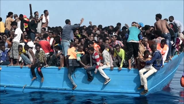 dramatic footage captured by afp shows a desperate rescue operation of hundreds of african migrants onboard an overcrowded wooden vessel found in... - abundance stock videos & royalty-free footage