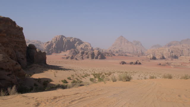 dramatic landscape of wadi rum desert, jordan - granite rock stock videos and b-roll footage