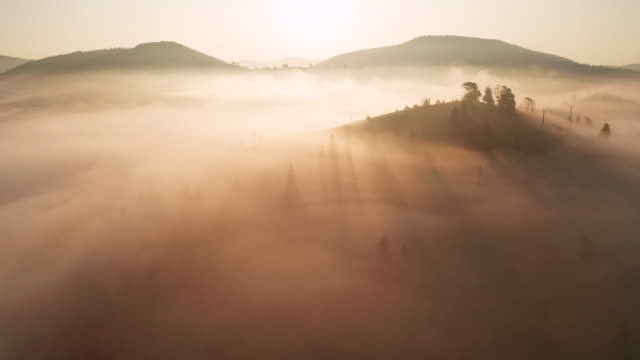 dramatic misty sunrise in the mountains. aerial view - austria stock videos & royalty-free footage