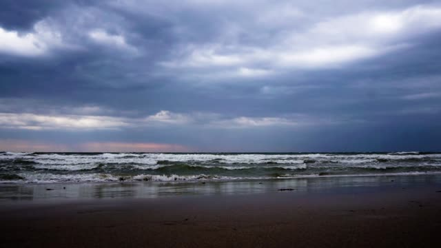 dramatic moody sky and waves as tropical storm pabuk approches - monsoon stock videos & royalty-free footage