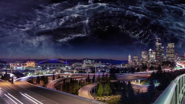 dramatic night sky above seattle city skyline - moody sky stock videos & royalty-free footage