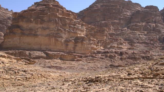 dramatic sandstone mountains in wadi rum desert, jordan - sandstone stock videos & royalty-free footage