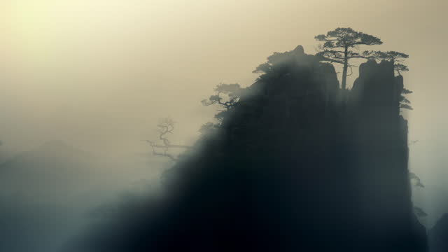 dramatic selective focus shots of silhouetted chinese landscape - dramatic landscape stock videos & royalty-free footage