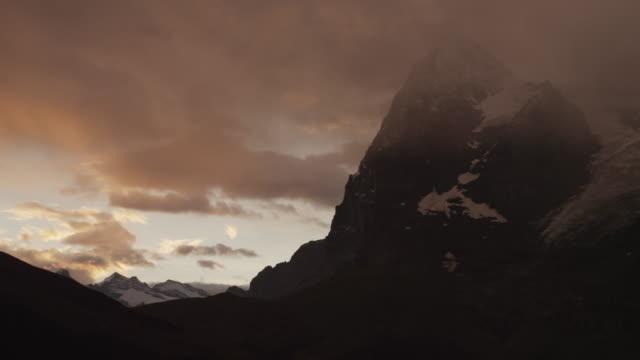 ws pan dramatic sky at sunset above alps / murren, switzerland - berner alpen stock-videos und b-roll-filmmaterial