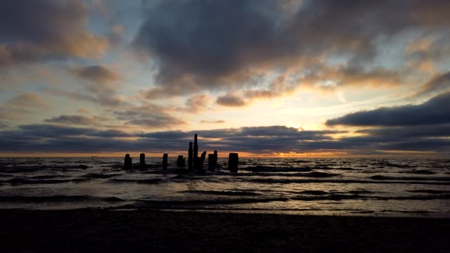 dramatic sky at sunset over the baltic sea. beach of nida, lithuania (timelapse) - lithuania stock videos & royalty-free footage