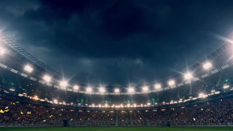 vídeos y material grabado en eventos de stock de espectacular estadio lleno de espectadores - reflector luz eléctrica