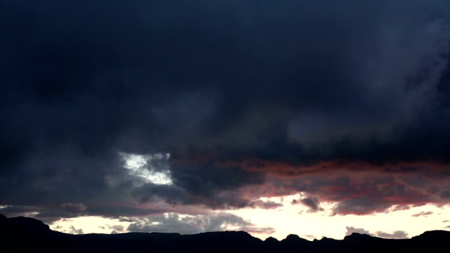 Dramatic storm clouds at sunset over Drakensburg mountains.South Africa