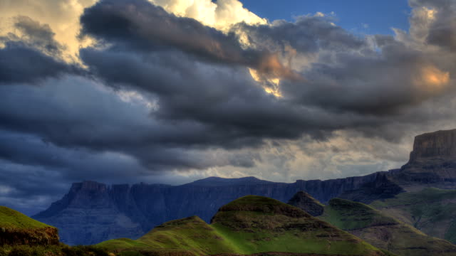 Dramatic storm clouds moving across the Amphitheatre at sunset. Drakensburg mountains. South Africa