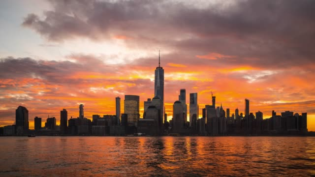 t/l ws dramatic sunrise over lower manhattan / new york city, usa - world trade center manhattan video stock e b–roll