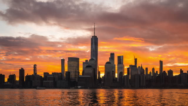 t/l ws zi dramatic sunrise over lower manhattan / new york city, usa - world trade center manhattan stock videos & royalty-free footage